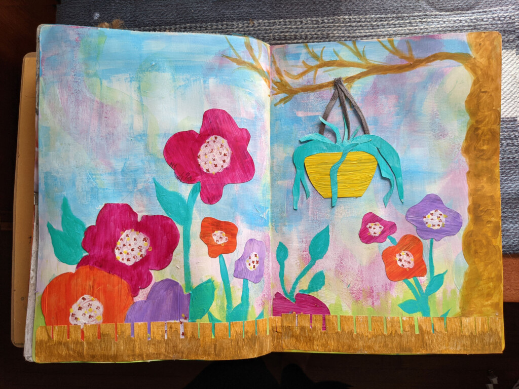 Image of a page in my art journal of big bright flowers, a tree, a fence and a hanging flower pot